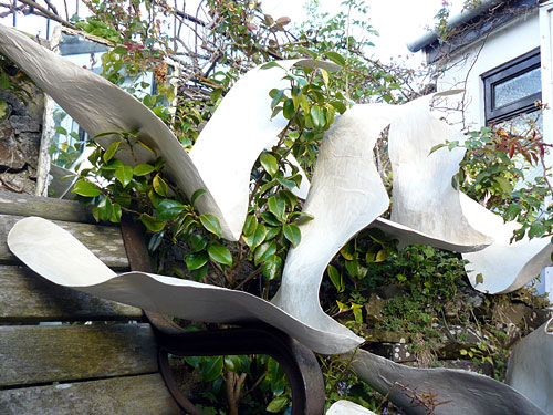 drying laminated paper shapes in the garden